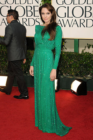looked classy in this gorgeous long-sleeved emerald green Versace dress.